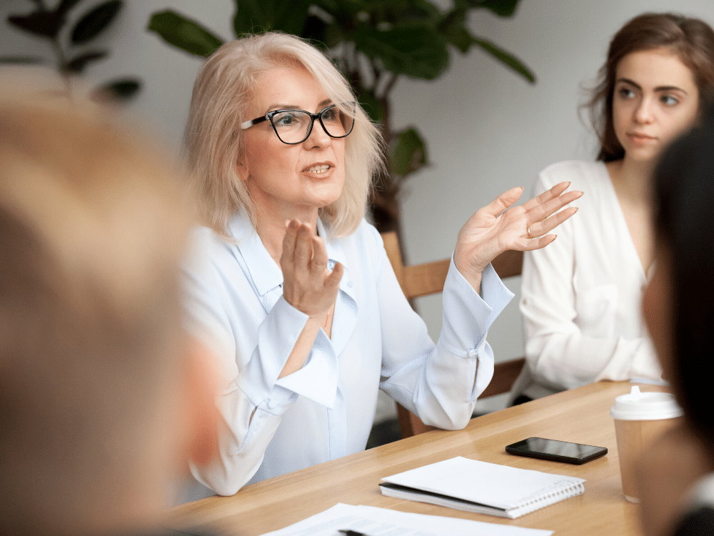 Woman speaking sitting in conference room